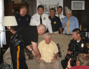 Placing GCSO Project Lifesaver Bracelet on Citizen